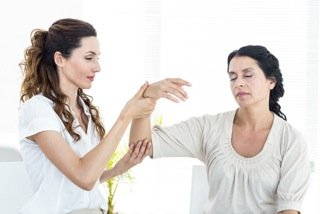 Two Women Demonstrating Arm Levitation Hypnotherapy